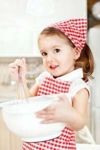 beautiful little girl baking