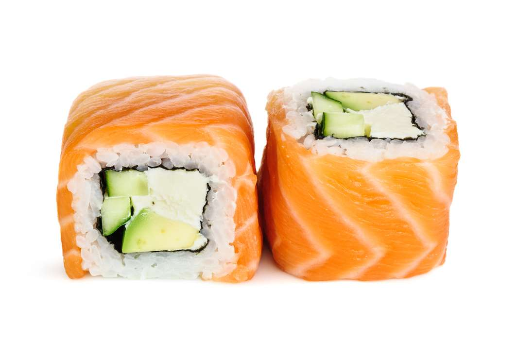 Uramaki maki sushi, two rolls isolated on white. Salmon with philadelphia, avocado and cucumber