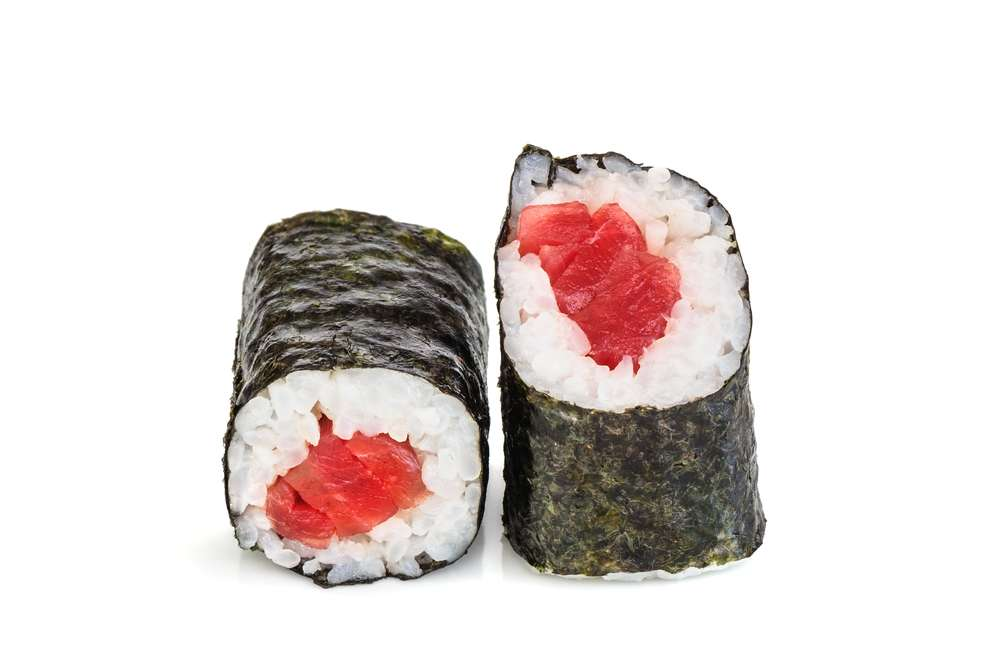 Simple maki sushi, two rolls isolated on white. Just nori, rice and tuna