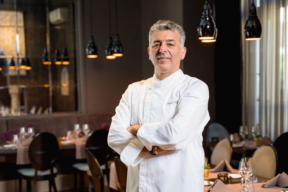 chef joseph hadad imbracat in costum de bucatr, fotografiat in restaurantul sau Joseph By Joseph Hadad