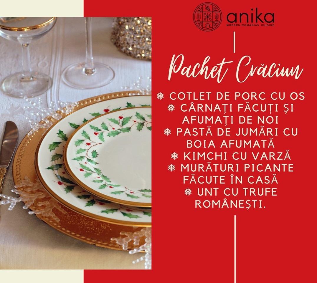 afis cu farfurii asezate pe masa si lista cu ce include pachetul de Crăciun de la Anika Restaurant
